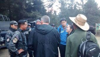 Policía Federal rescata a tres chinos y un mexicano perdidos en zona serrana de Michoacán
