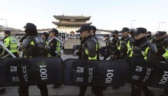 Durante las protestas por el fallo contra Park, dos personas murieron. (AP)