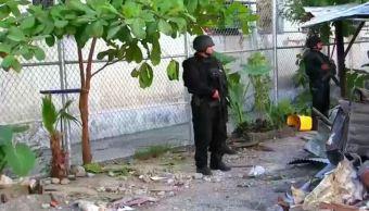 Un policía durante un operativo en el penal donde se fugaron 29 reos (Noticieros Televisa)