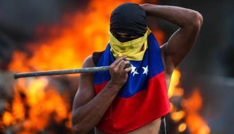 Gobierno de Venezuela y oposición se señalan mutuamente por la violencia que dejó más de 20 muertos. (EFE)