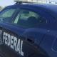 Patrulla de la Policia Federal estacionado en una autopista