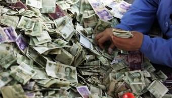 Billetes chinos de baja denominación. (Getty Images)