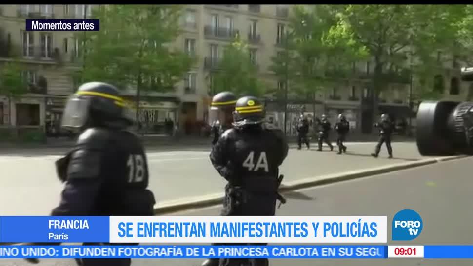 Policías, grupos de encapuchados, manifestación, mayo