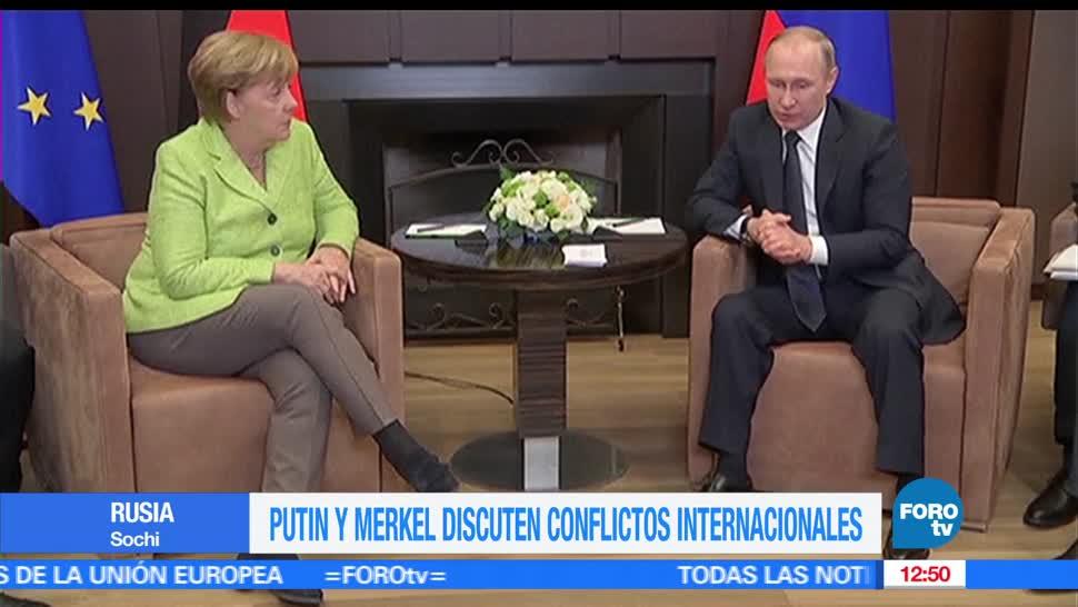Putin, Merkel, conflictos internacionales, Siria y Ucrania