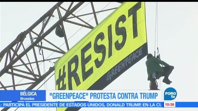 Bélgica, activistas de Greenpeace, manta, Resistir, protesta, visita de Donald Trump