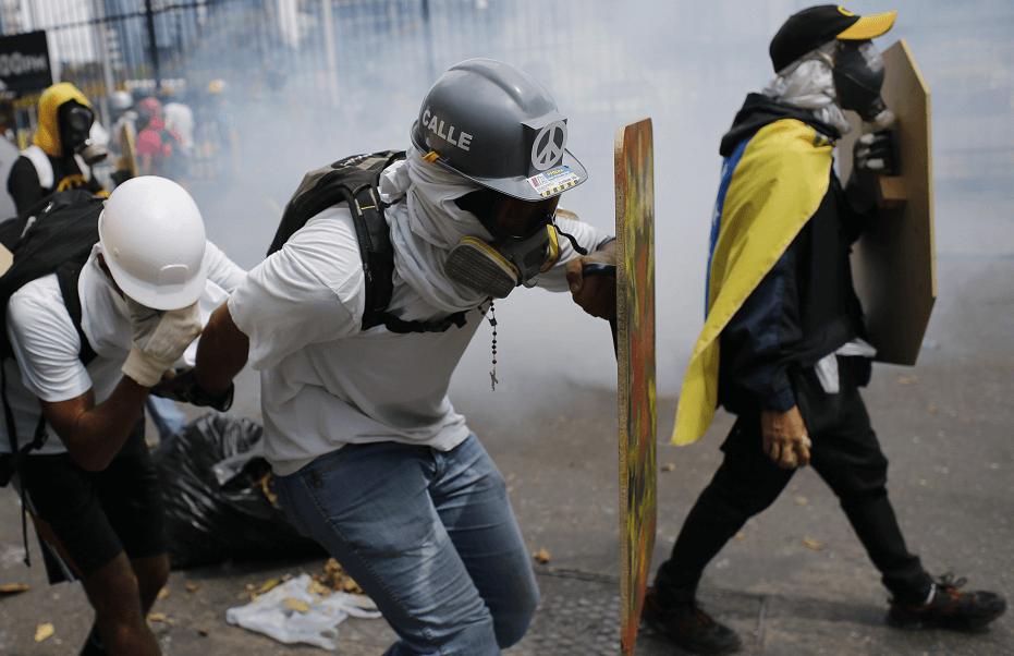 Manifestantes venezolanos durante marcha contra Maduro