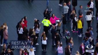 Policías, bailan, Manchester, concierto