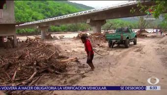 daños en 26 carreteras, carreteras de Oaxaca, tormenta tropical, Calvin, tierra