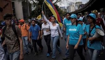 María Corina Machado, lideresa de la oposición venezolana, encabeza una marcha