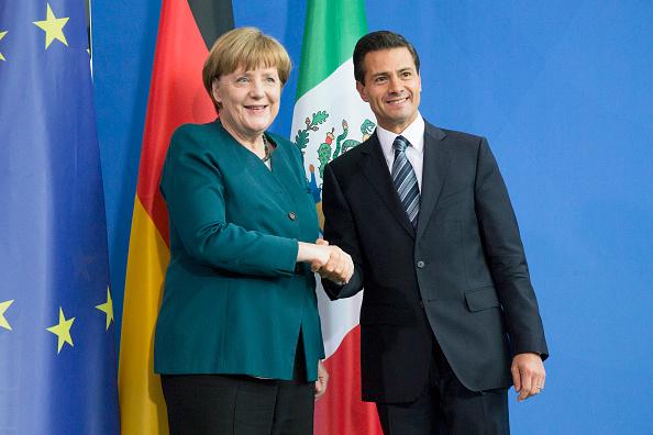 Angela Merkel y Enrique Pena participan en conferencia