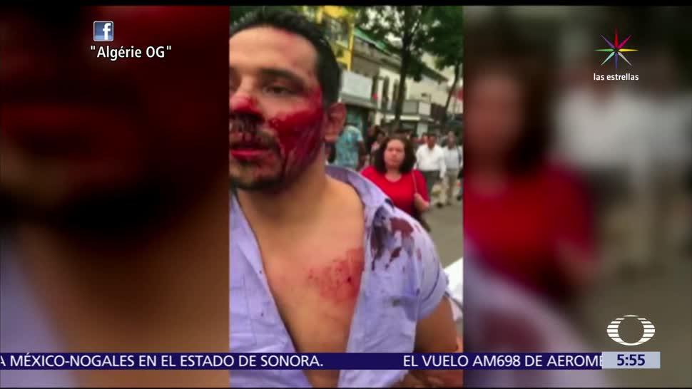 joven es golpeado, policías de la CDMX, 'araña' inmovilizadora, mal estacionado