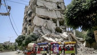 siria, damasco, niños sirios, edificios derrumbados, disparos