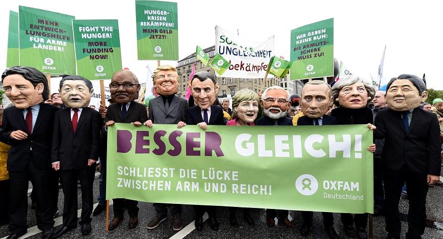 Grandes cabezas representan a los líderes del G20 en protesta ante la próxima cumbre del G20 en Hamburgo, Alemania (Reuters)