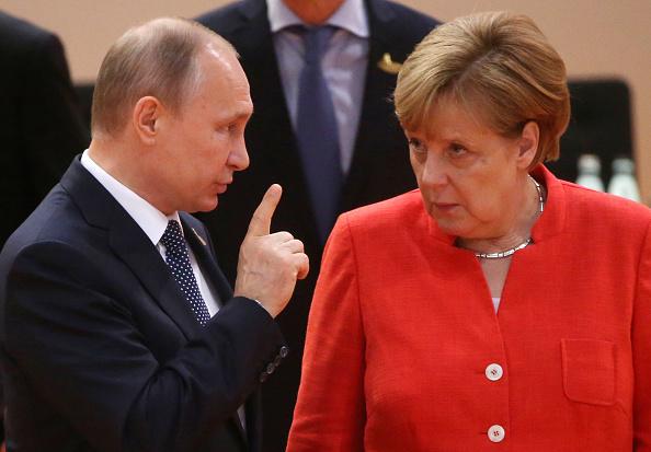 Vladimir Putin y Angela Merkel, en la Cumbre del G20