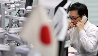 Operador de la Bolsa de Tokio negocia vía telefónica