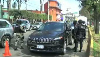 Policías detienen vehículos en retén de seguridad en Veracruz