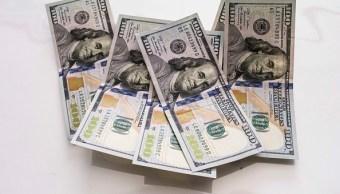 El dólar se vende en 18.08 pesos en bancos