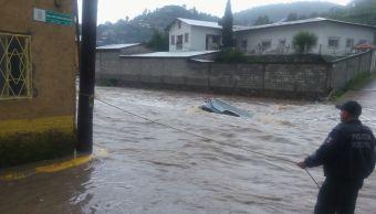 Lluvias desbordan presa en Chihuahua; buscan a tres desaparecidos