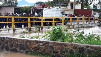 Evacuan municipios de Michoacán por desbordamiento de ríos y fuertes lluvias