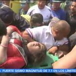 Rescatan con vida a mujer atrapada entre escombros en la Colonia del Valle