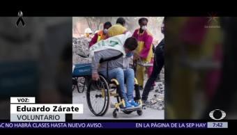 Joven en silla de ruedas apoya rescates tras sismo en CDMX