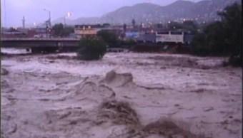 El huracan gilberto provoca un torrente salvaje en monterrey