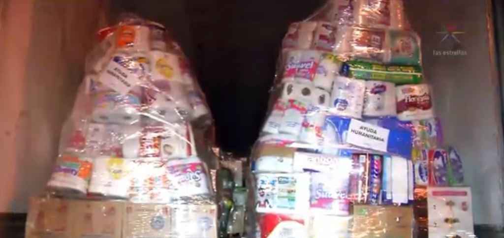 Parten del Zócalo tres tráileres con ayuda humanitaria