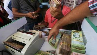 Venezuela posterga la venta de divisas