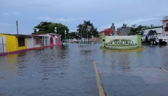 Por desborde de ríos continúan afectados los municipios de Tlacotalpan y Minatitlán