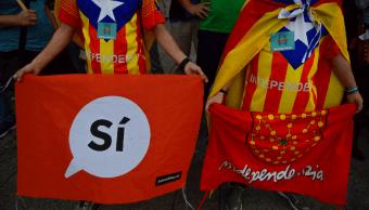 Votantes independentistas durante manifestación en Cataluna