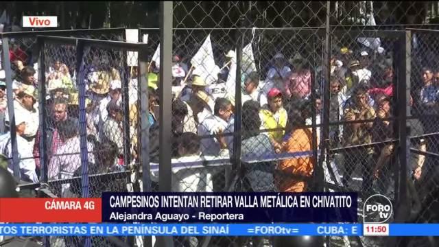 Granaderos contienen a manifestantes en Chivatito, CDMX