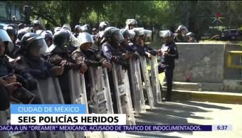 Seis policías CDMX resultan heridos por petardos de manifestantes