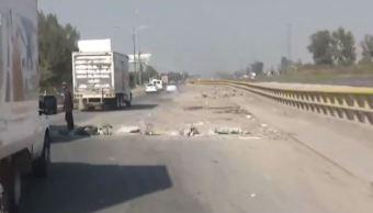 Automovilistas denuncian que baches en Periférico Oriente propician asaltos