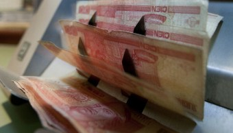 Peso mexicano pierde tras conclusión de la quinta ronda del TLCAN