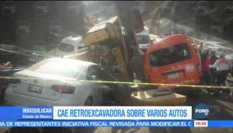 Mueren dos personas por caída de retroexcavadora en Huixquilucan