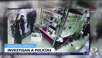 Investigan a policías que extrajeron celulares en Plaza Meave de la CDMX