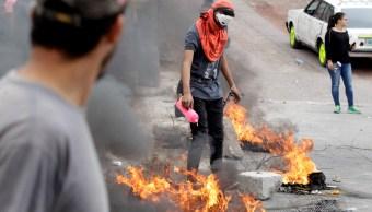 """Al menos un muerto en manifestación contra el """"fraude"""" en Honduras"""