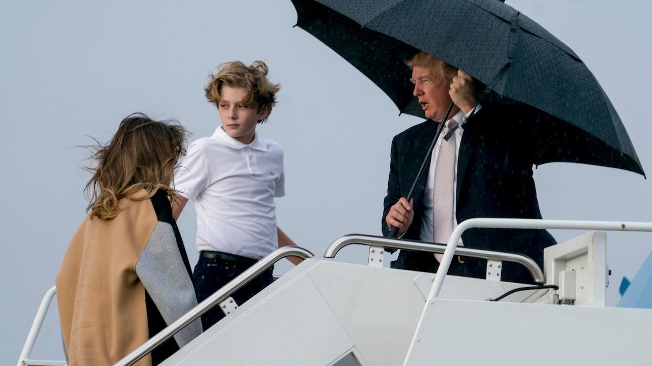 Donald Trump, Melania Trump, paraguas, lluvia