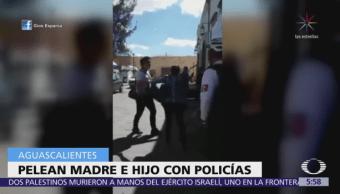 Madre e hijo pelean con polic Madre e hijo pelean con policías en Aguascalientesías en Aguascalientes