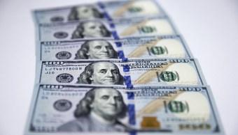El dólar cierra en 19.23 pesos.