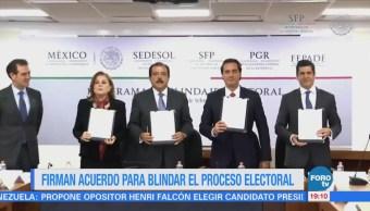 Firman convenio para blindaje electoral