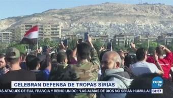 Sirios celebran defensa de sus tropas