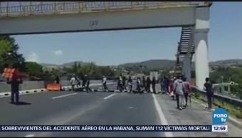 Bloquean autopista México-Puebla en el kilómetro