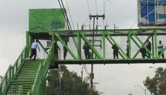 Delincuentes asesinan a guardia de seguridad en puente peatonal de Ecatepec