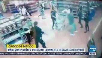 Riña entre policías y presuntos ladrones en CDMX