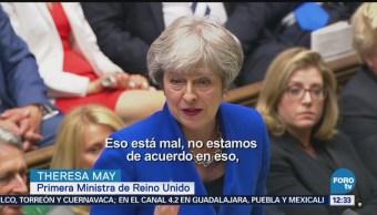 Theresa May condena separación de familias migrantes en EU