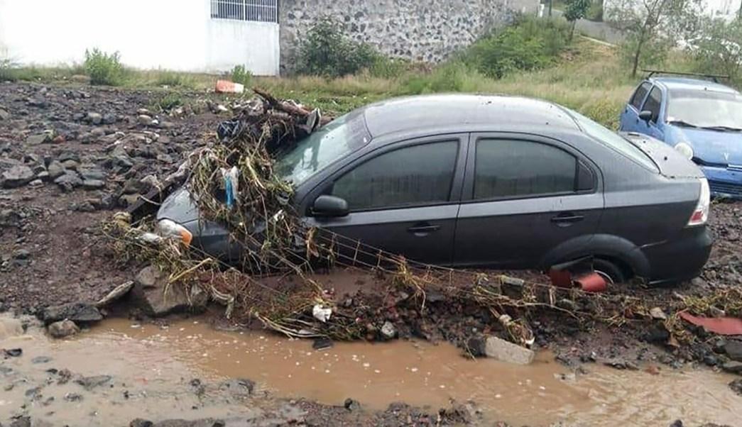 Tromba en Morelia afectó al menos 60 viviendas y decenas de vehículos