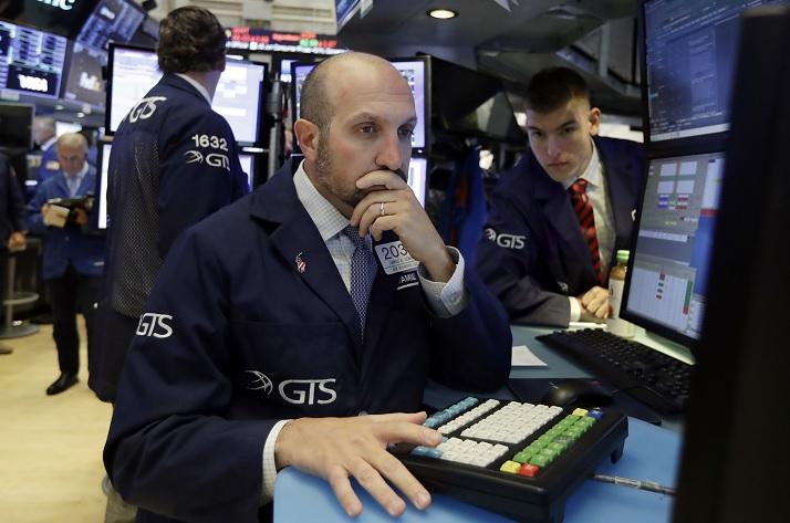Wall Street cierra ganancias y récord Nasdaq