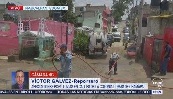 Militares ayudan a desazolvar tres viviendas en Naucalpan