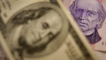 Peso mexicano cae, cotización del dólar a 19.17